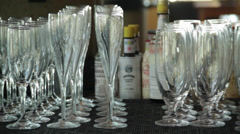 The glass tumblers are in various designs and sizes arranged in a wine bar Stock Footage