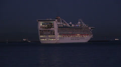 Cruise Ship Leaves Port At Night Stock Footage