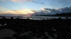 Lava Rocks at sunset on a Hawaii beach Stock Footage