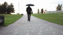 People passing in the distance ( and coming back) Stock Footage