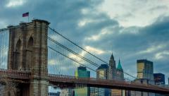 Epic Clouds Sweep Behind Brooklyn Bridge Timelapse at Sunset Stock Footage