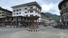 Time lapse video of people in the intersection of a Bhutan town Stock Footage