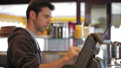 Man at cash register - close up - stock footage