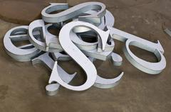The metal font making / raw material for sign maker Stock Photos