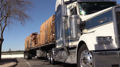 Big rig semi trucks loaded with cut lumber Stock Footage