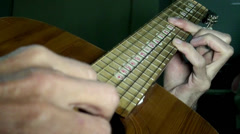 Playing guitar chords hand string Stock Footage