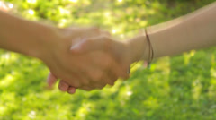 Children agree on green background, hands close-up, peace - stock footage