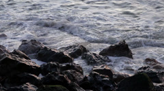 Small Waves Breaking on Rocks Stock Footage