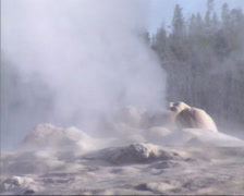 Steaming fumarole of Old Faithfull geyser in Yellowstone National Park Stock Footage