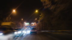Night city. Winter. Snow-covered trees. Traffic through the city streets Stock Footage