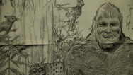 Bigfoot drawing close face pan left right big foot sketch angry monster Stock Footage