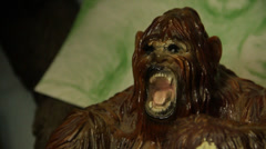 The Person sees the gorilla statuette sasquatch big foot bigfoot monster  - stock footage
