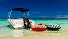 Boat in green water on Mauritius beach, postcard motive - stock photo