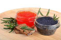 caviar with bread and rosemary - stock photo