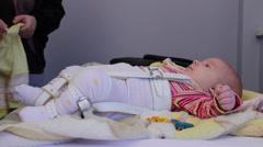SRBIJA, KRUSEVAC, 04.02.2014. PUBLIC HOSPITAL. Examination of the hip in babies. Stock Footage