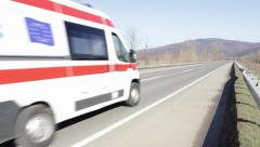 Ambulance van going at high speed on a transit route. Ambulance on the open road Stock Footage