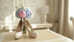 Bridal bouquet and the bride's shoes Stock Footage