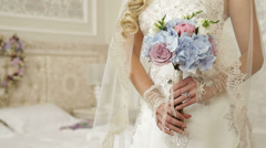 Wedding bouquet in bride hands against background of  wreath in  shape of heart Stock Footage