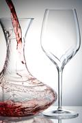 pouring wine into decanter - stock photo