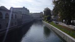 AERIAL: Padlocks on river bridge fence Stock Footage