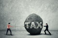 Stock Illustration of big tax as business obstacle
