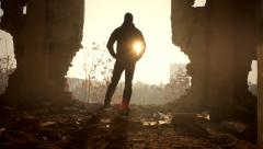 Man Walking Toward Hope Sun Light Out of Darkness Destruction Stock Footage