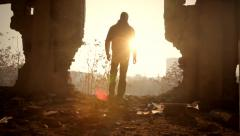 Man Walking Toward Sunlight Abandoned Building Salvation Stock Footage