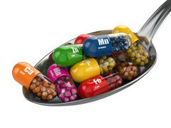Stock Illustration of dietary supplements. variety pills. vitamin capsules on the spoon.