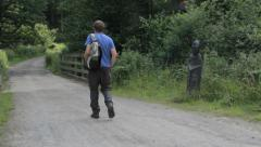 Man Walking The Mercian Way, Wyre Forest, Worcestershire, England Stock Footage