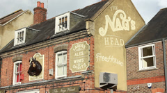 Bus passes Nags Head pub, UK - stock footage