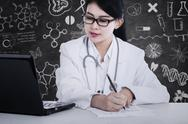 Stock Illustration of doctor writes medical reports