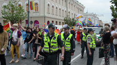 Huge policeman force protect public gay parade participants Stock Footage