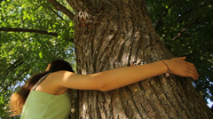 Girl coming and hugging the tree, save the nature Stock Footage