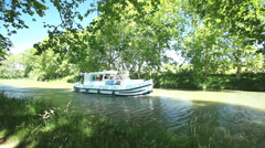 Passengers on boat in summer on June 22, 2013 on the Canal du Midi, France. Stock Footage