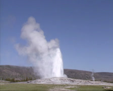 Eruption Old Faithful geyser in Yellowstone National Park - wide shot Stock Footage