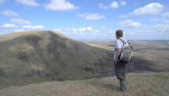 Male Walker at Lochcraig Head Mountain, Dumfries & Galloway Scotland UK Stock Footage