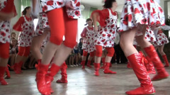 Girls in red knee-boots dance beautiful dance Stock Footage
