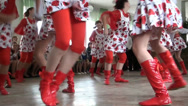 Stock Video Footage of Girls in red knee-boots dance beautiful dance