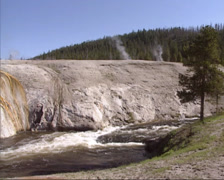 River in Upper Geyser Basin, tilt down hot spring with mineral depositions Stock Footage