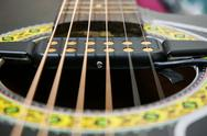 Stock Photo of external pickup for acoustic guitar