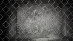 Old abandoned storage warehouse with chain link fence Stock Footage