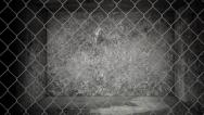 Stock Video Footage of Old abandoned storage warehouse with chain link fence