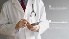 Male doctor in white coat is using a modern smartphone device with touch screen Stock Footage