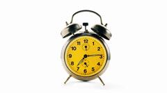 Vintage alarm clock over white background ringing at quarter past seven Stock Footage