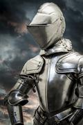 Stock Photo of safety.medieval armor over clouds background. concept of firewall protection