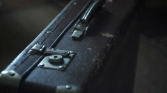 Vintage suitcase stands on the floor Stock Footage