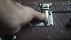 man opens an vintage suitcase - stock footage