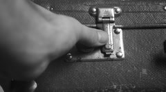 Man opens an vintage suitcase,black and white Stock Footage