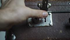 Man closes an vintage suitcase Stock Footage