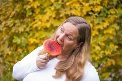 woman and fly agaric - stock photo
